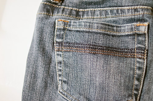 Old jeans faded pockets