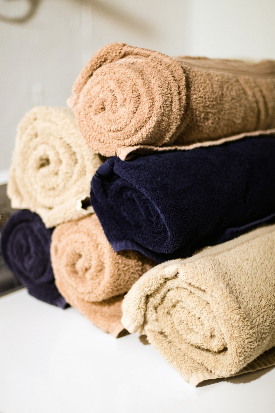 freshly washed and rolled towels