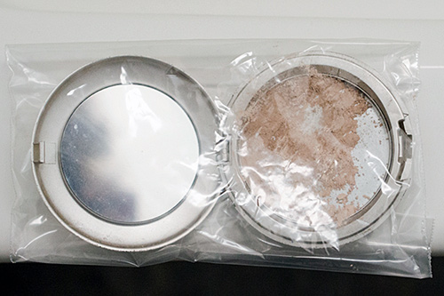 seal the compact in plastic and mash the makeup good