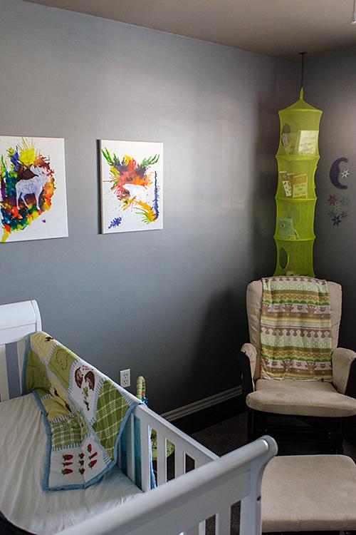baby boy nursery glider and mesh hanging organizer